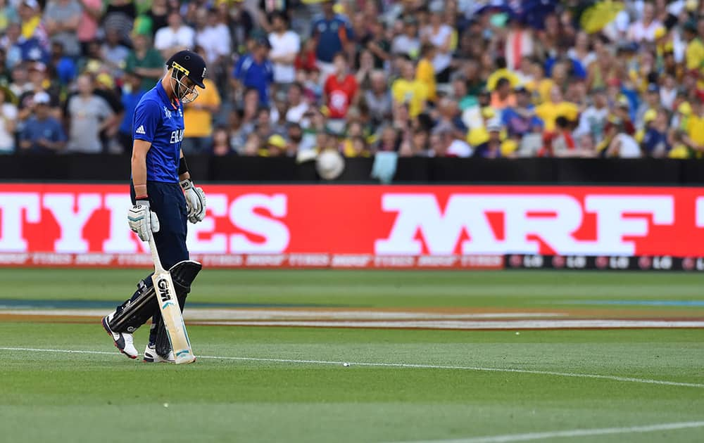 England's Joe Root walks off the field after his wicket fell during their Cricket World Cup pool A match against Australia in Melbourne, Australia.