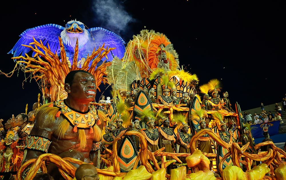 Dancers from the Nene de Vila Matilde samba school perform on a float during a carnival parade in Sao Paulo.