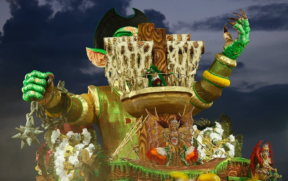 Dancers from the Nene de Vila Matilde samba school perform on a float during a carnival parade in Sao Paulo, Brazil.