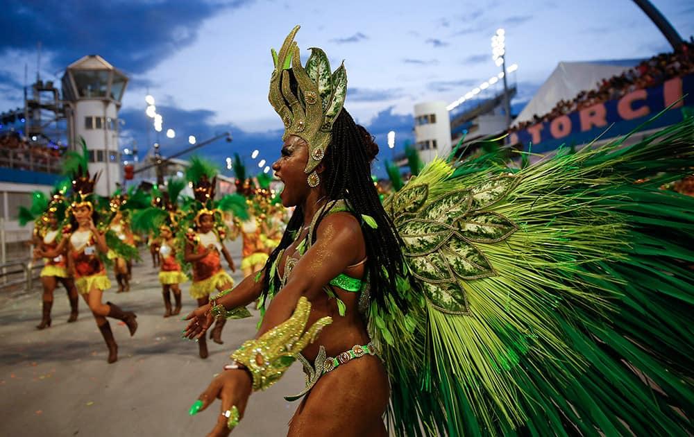 A dancer from the Nene de Vila Matilde samba school performs during a carnival parade in Sao Paulo, Brazil.