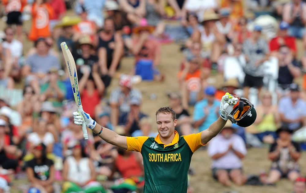 South Africa's David Miller raises his bat and helmet after making 100 runs against Zimbabwe during their Cricket World Cup pool B match at Hamilton, New Zealand.
