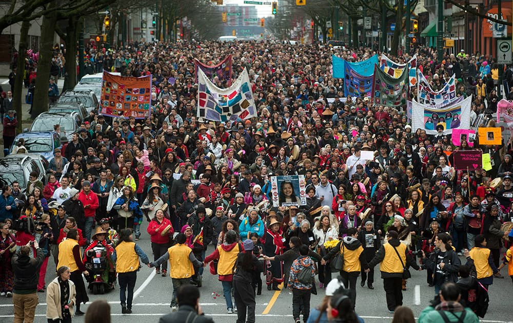 Hundreds of people march through the Downtown Eastside during the 25th annual Women's Memorial March in Vancouver, Canada.