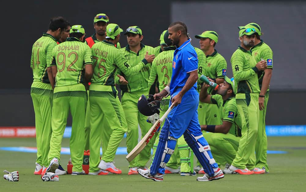Shikhar Dhawan, walks back after he was run out during the World Cup Pool B match against Pakistan in Adelaide, Australia.