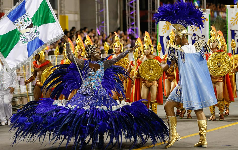 Dancers from the Vila Maria samba school perform during a carnival parade in Sao Paulo, Brazil.