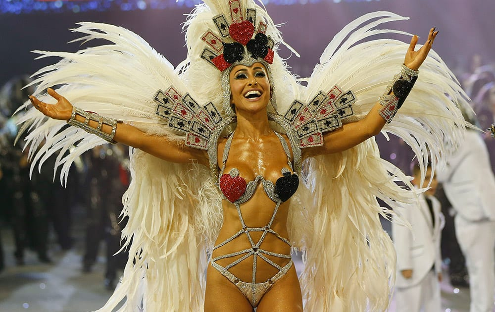 Brazilian model and comedian Sabrina Sato, from the Gavioes da Fiel samba school, performs during a carnival parade in Sao Paulo, Brazil.