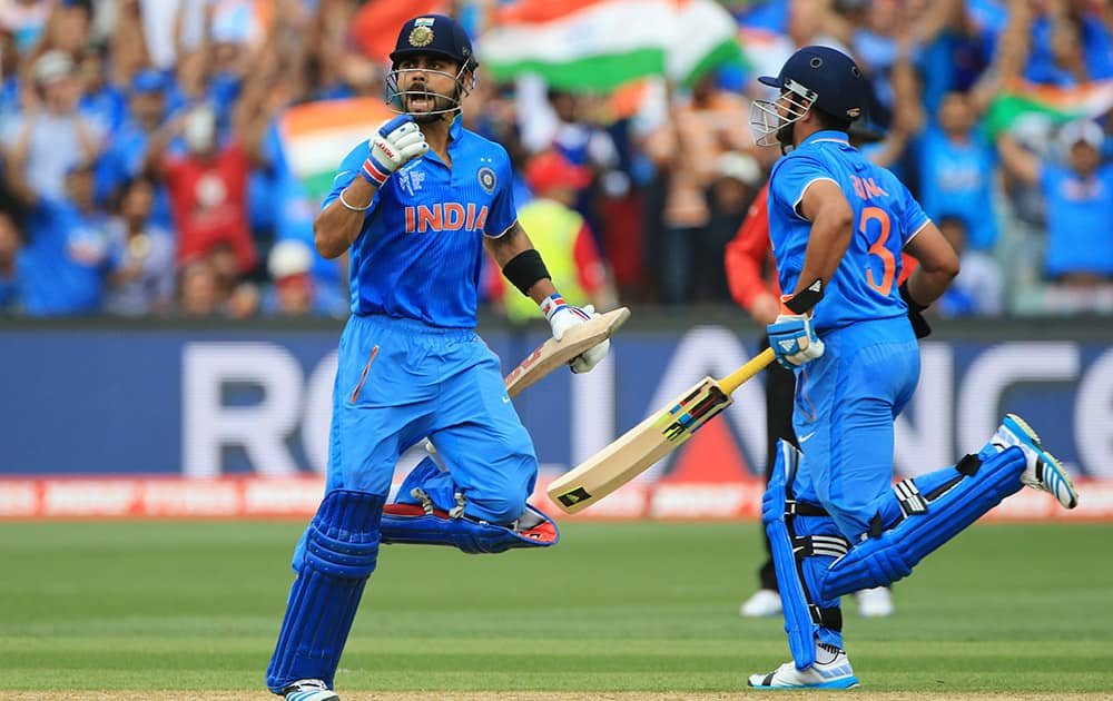 Virat Kohli, celebrates his hundred during the World Cup Pool B match against Pakistan in Adelaide.
