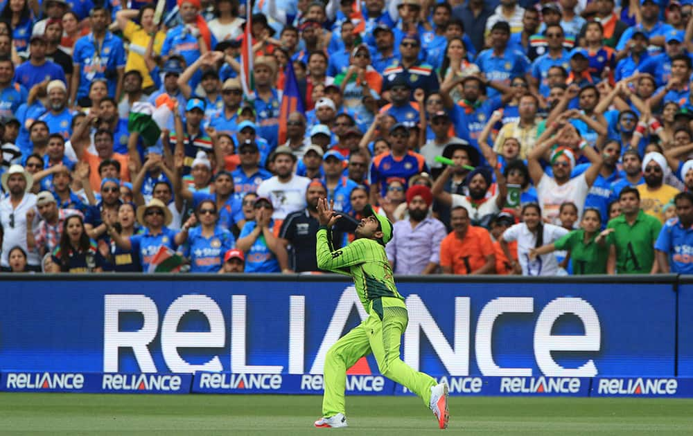 Pakistan's Haris Sohail prepares to take a catch to dismiss India's Suresh Raina during the World Cup Pool B match in Adelaide, Australia.