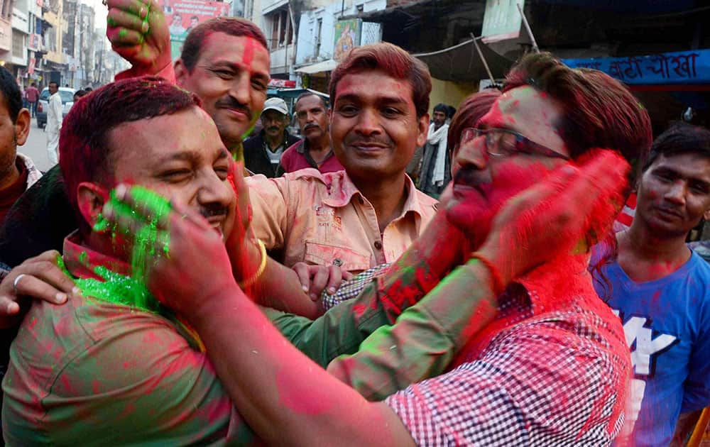 People celebrate team Indias victory against Pakistan in ICC World Cup cricket match, in Allahabad.