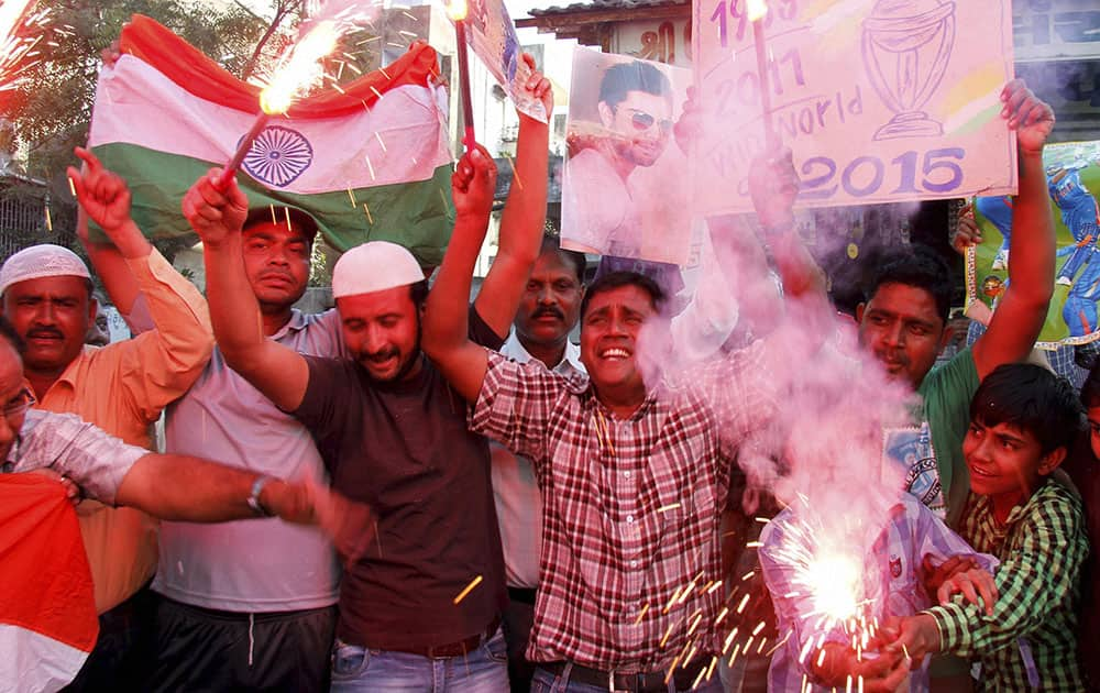 Cricket fans celebrating after team India's victory in the ICC World Cup Pool B match against Pakistan, in Ahmedabad.