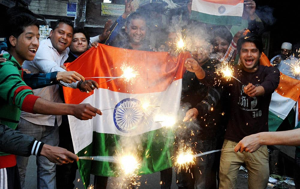 Cricket fans celebrate after team India's victory in the ICC World Cup Pool B match against Pakistan, in Amritsar.