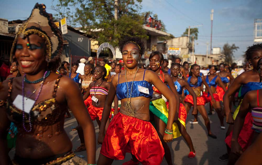 Dancers perform in a street parade, kicking off Carnival celebrations in Port-au-Prince, Haiti.