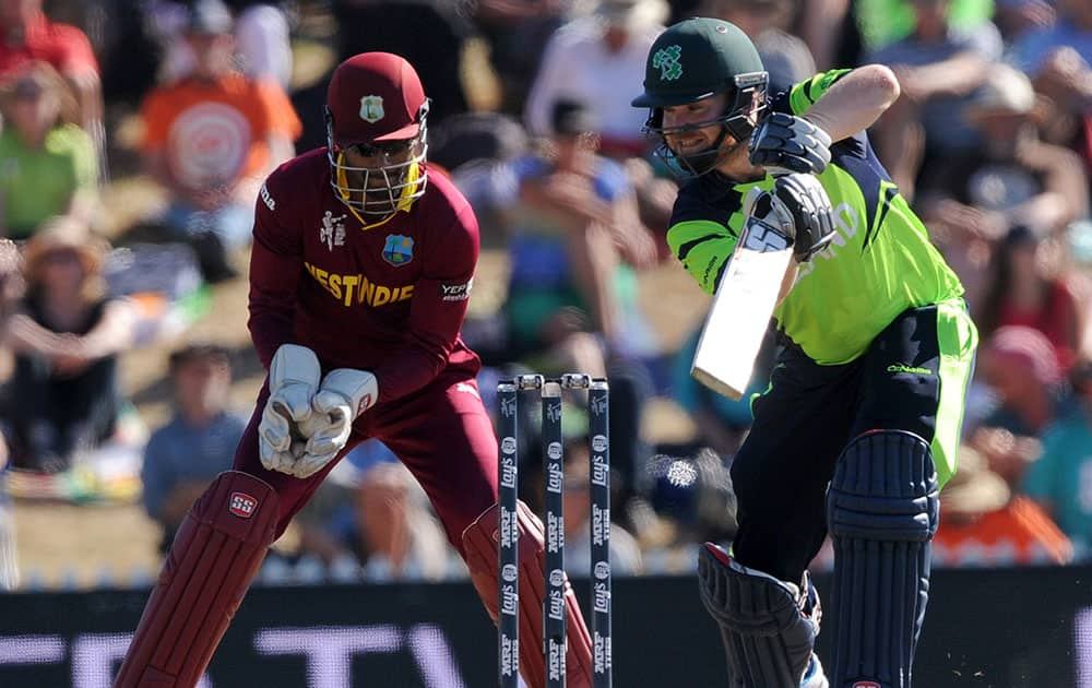 West Indies's Denesh Ramdin, left, catches the ball edged by Ireland's Paul Stirling, right, during their Cricket World Cup pool B match at Nelson, New Zealand.