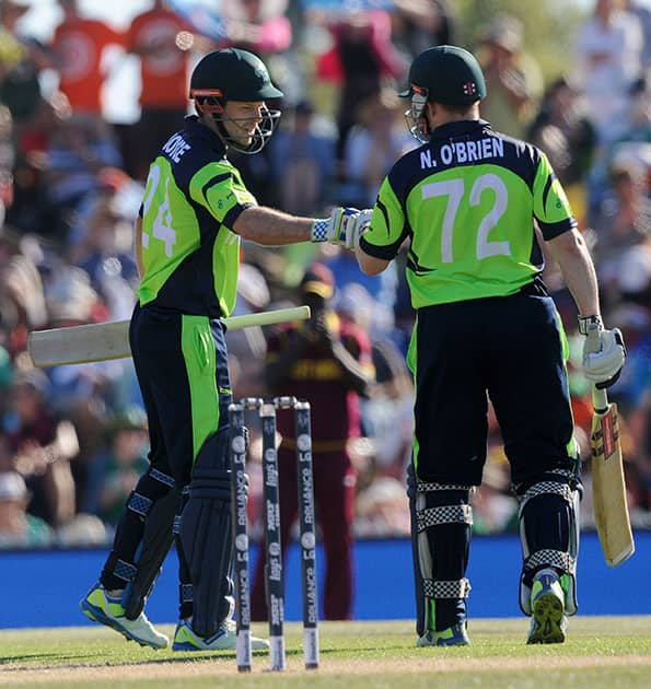 Ireland's Ed Joyce, left, and Niall O'Brien meet mid-pitch during their Cricket World Cup pool B match against West Indies at Nelson, New Zealand.