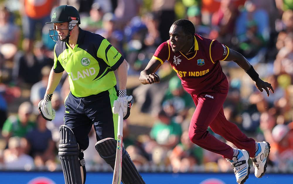 West Indies' Jerome Taylor, right, flies as he delivers a ball watched by Ireland's Niall O'Brien during their Cricket World Cup pool B match at Nelson, New Zealand.