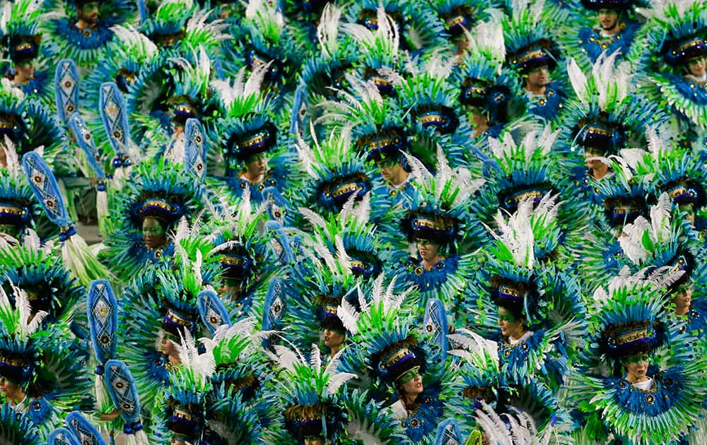 Performers from the Vila Isabel samba school parade during carnival celebrations at the Sambadrome in Rio de Janeiro, Brazil.