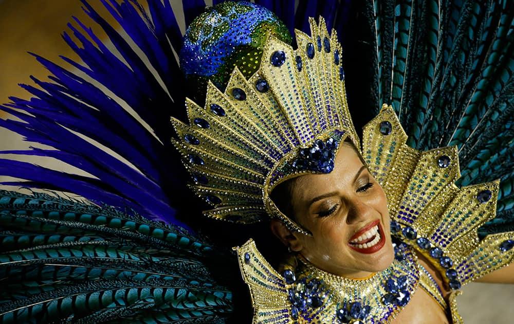 A performer from the Academicos do Grande Rio samba school parades during carnival celebrations at the Sambadrome in Rio de Janeiro, Brazil.