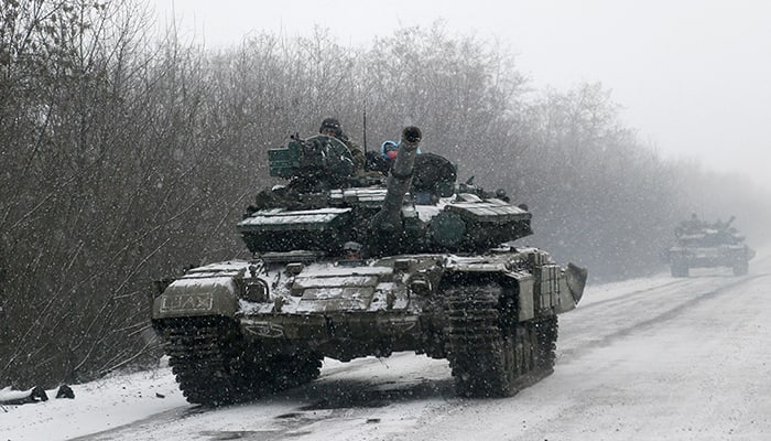 An Ukrainian armored vehicles drive on the road between the towns of Debaltseve and Artemivsk, Ukraine.