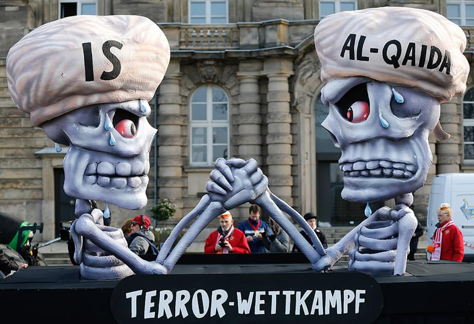 A carnival float depicts a writing 'terror competition' underneath skeletons with turbans and the writings IS and Al-Qaida during the traditional Rose Monday carnival parade in Duesseldorf, Germany.