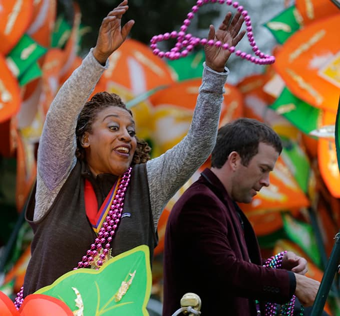 CCH Pounder, actress on the television series NCIS New Orleans, throws beads from a float during the Krewe of Proteus parade in New Orleans. The day is known as Lundi Gras, the day before Mardi Gras.