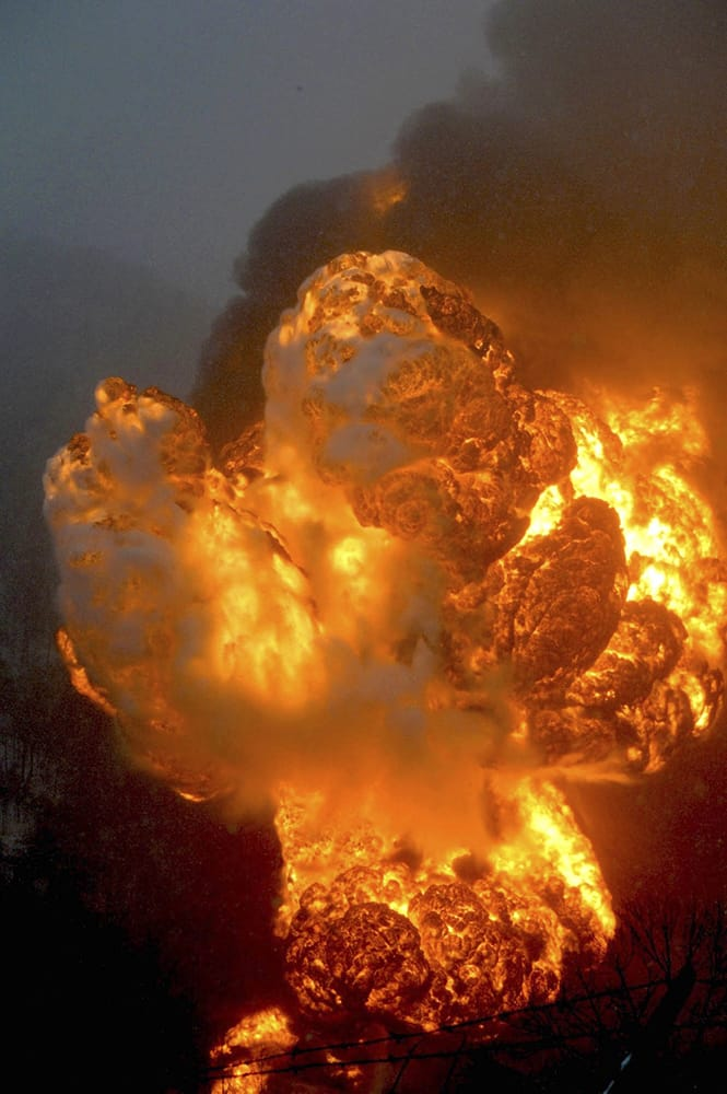 A fire burns, after a train derailment near Charleston, W.Va. Nearby residents were told to evacuate as state emergency response and environmental officials headed to the scene.