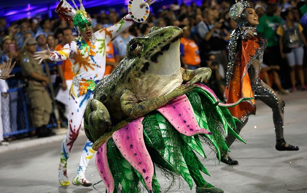 Performers from the Portela samba school, parade during Carnival celebrations at the Sambadrome in Rio de Janeiro, Brazil.