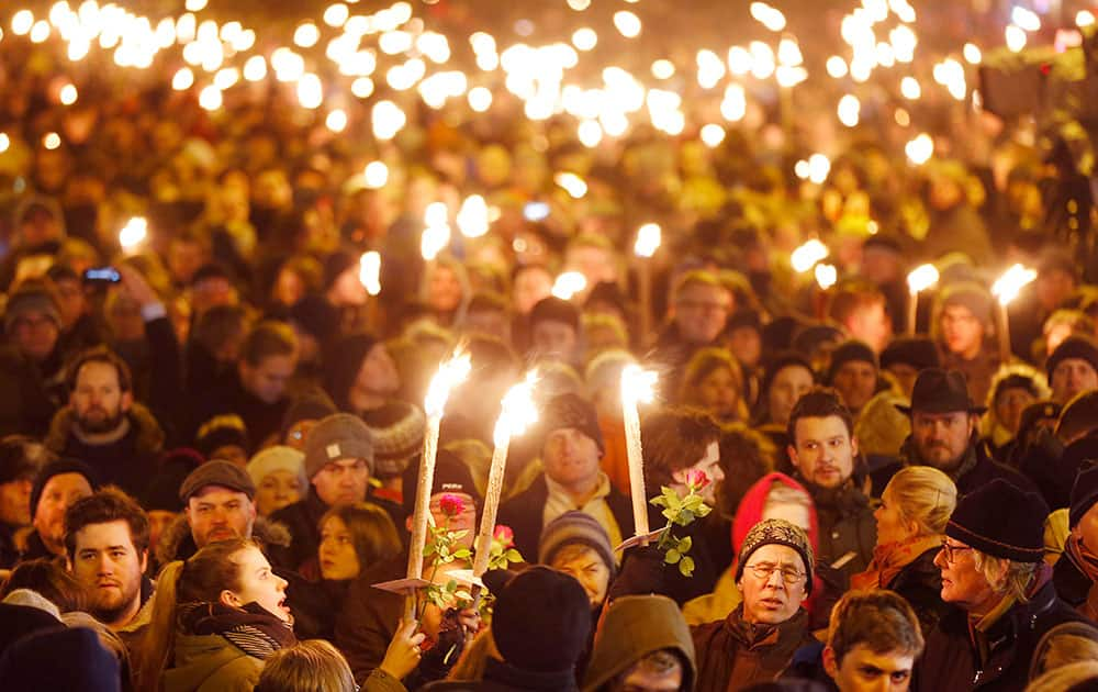 Hundreds of people gather for a vigil near the cultural club in Copenhagen, Denmark.