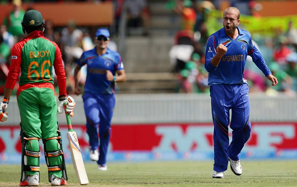 Afghanistan bowler Ashraf Merwais celebrates after dismissing Bangladesh's Haque Anamul for 29 runs during their Cricket World Cup Pool A match in Canberra, Australia.