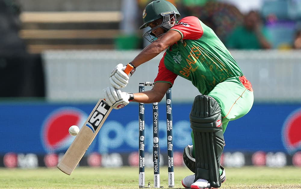 Bangladesh's Mahmudullah hits the ball during their Cricket World Cup Pool A match against Afghanistan in Canberra, Australia.