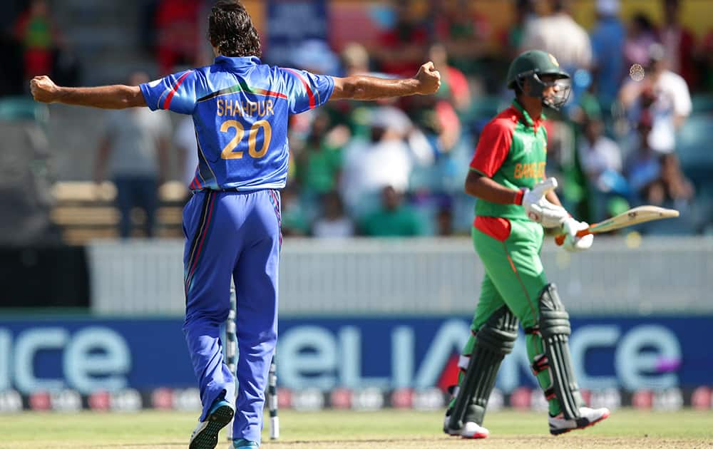 Afghanistan's Zadran Shapoor celebrates after dismissing Bangladesh batsman Mahmudullah, during their Cricket World Cup Pool A match in Canberra, Australia.