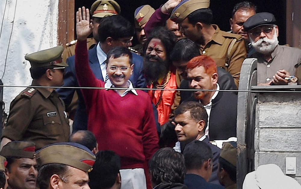 Delhi Chief Minister Arvind Kejriwal waves to supporters at a Janata Darbar at Aam Aadmi Partys Kaushambi office in Ghaziabad.