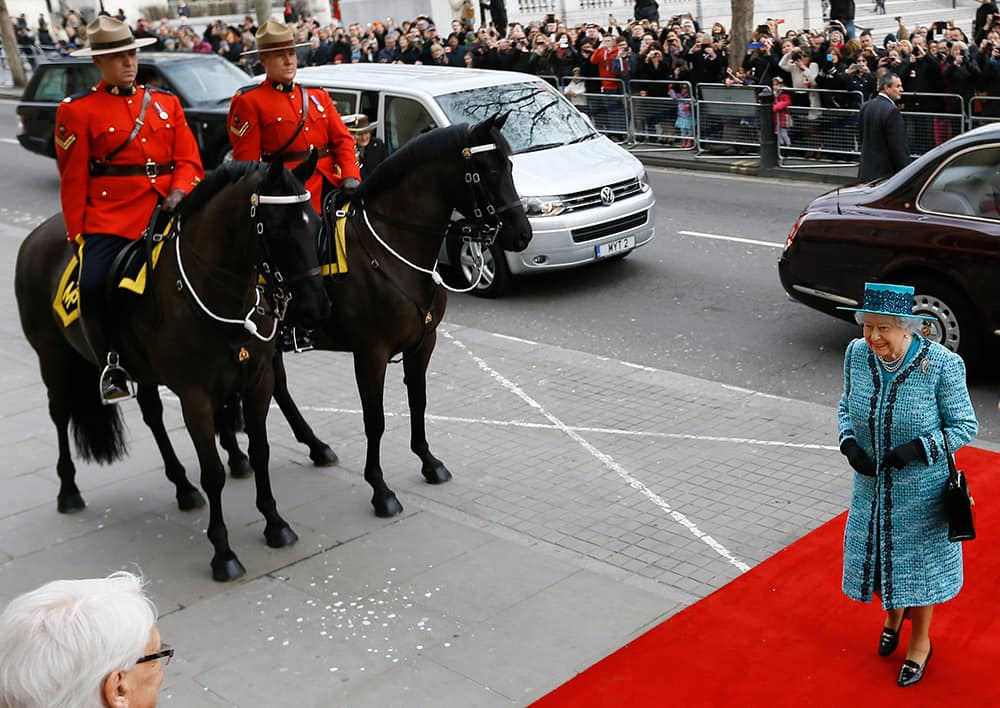 Britain's Queen Elizabeth II arrives to officially reopen Canada House following an extensive programme of restoration and refurbishment, on Trafalgar Square in London.
