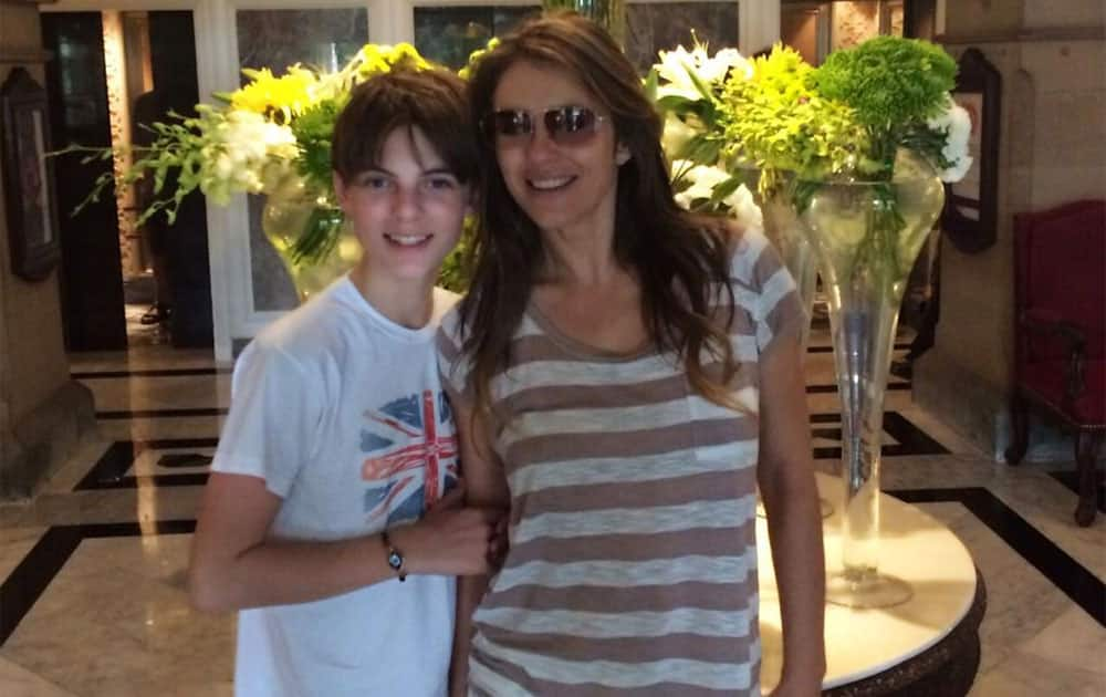 In the glorious Taj Hotel with my giant 12 year old. India  - twitter @ElizabethHurley