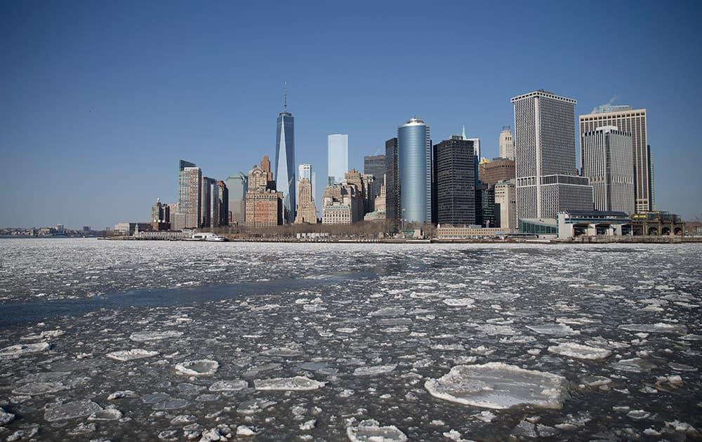 Ice flows pass through New York Harbor, in New York.
