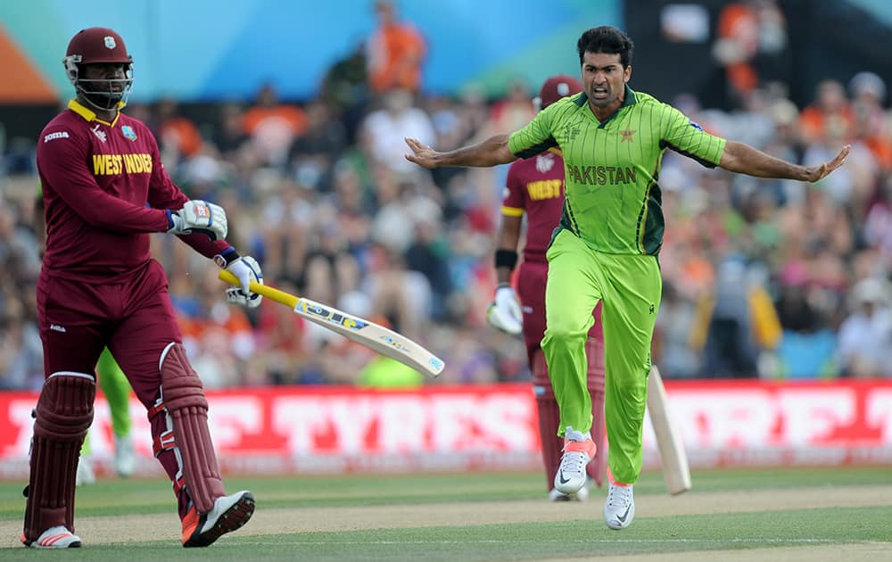 Pakistan bowler Sohail Khan, right, celebrates after taking the wicket of West Indies batsman Dwayne Smith, left, during their Cricket World Cup match in Christchurch, New Zealand.
