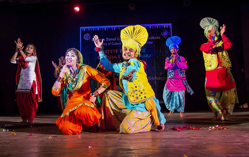 Folk dance artists from Punjab perfoming Bhangra during a show Bharat Lok Parv organized by Eastern Zonal Cultural Centre in Sivasagar in Assam.