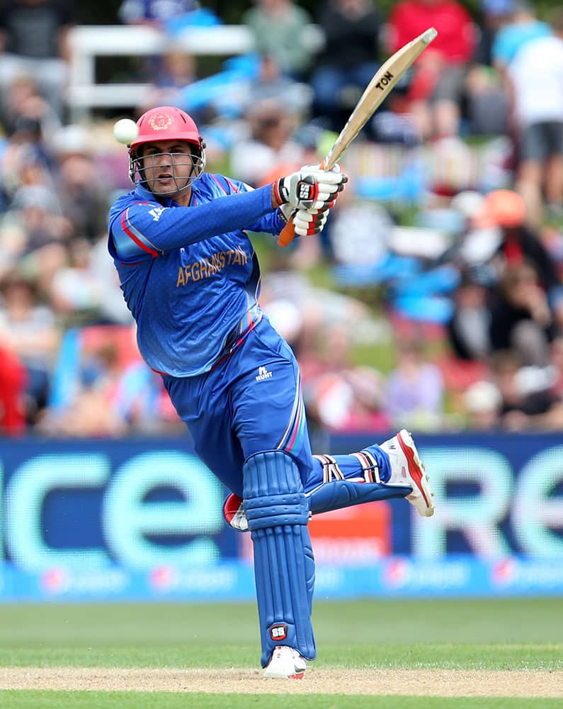 Afghanistan's Mohammad Nabi hits the ball during their Cricket World Cup match against Sri Lanka in Dunedin, New Zealand.