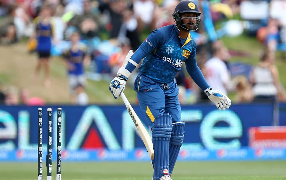 Sri Lankan batsman Kumar Sangakkara reacts after he was bowled by Afghanistan's Hamid Hassan for seven runs during their Cricket World Cup match in Dunedin, New Zealand.