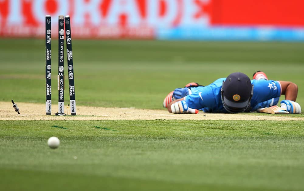 India's Rohit Sharma lies on the ground after he was run out during their Cricket World Cup pool B match against South Africa in Melbourne, Australia.