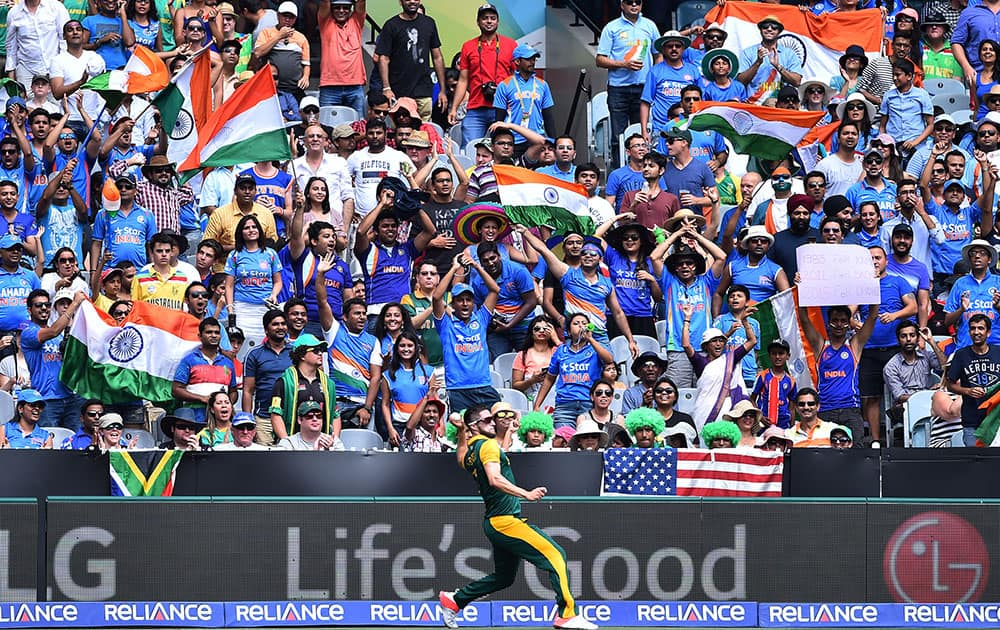 South Africa's Wayne Parnell throws the ball back to his teammates during their Cricket World Cup pool B match India in Melbourne, Australia.