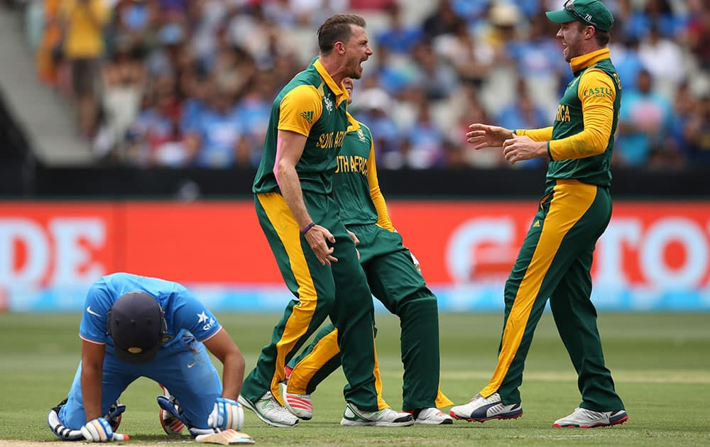 South African players celebrate the wicket of India's Rohit Sharma during their Cricket World Cup pool B match in Melbourne, Australia.