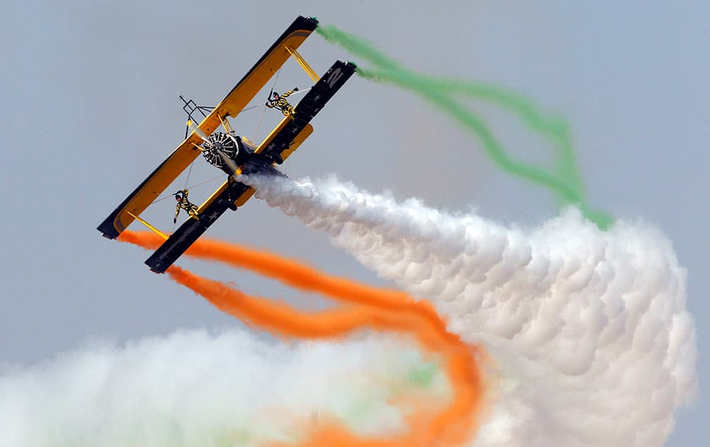 Skycat Wingwalkers from the Scandinavian Airshow aerobatic team perform on the forth day of Aero India 2015 at Yelahanka air base in Bangalore, India.