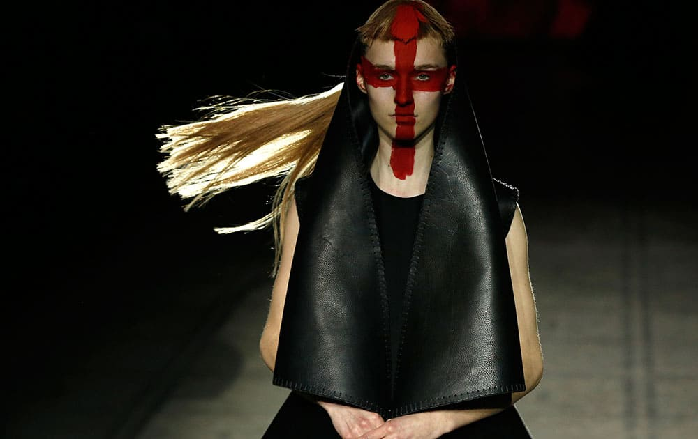 A model wears an outfit by designer Gareth Pugh during his Autumn/Winter 2015 show at London Fashion Week.