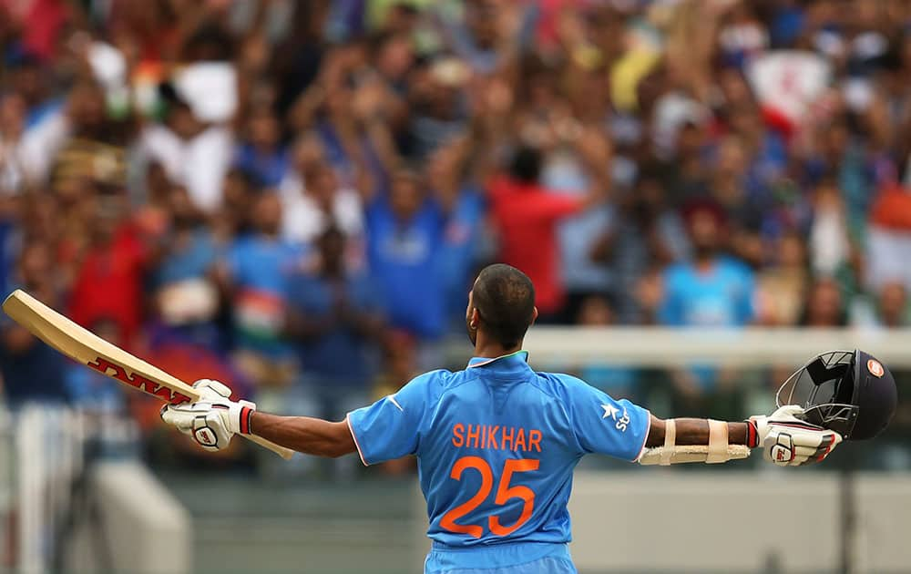 INDIA'S SHIKHAR DHAWAN CELEBRATES HIS HUNDRED DURING THEIR CRICKET WORLD CUP POOL B MATCH AGAINST SOUTH AFRICA IN MELBOURNE, AUSTRALIA.