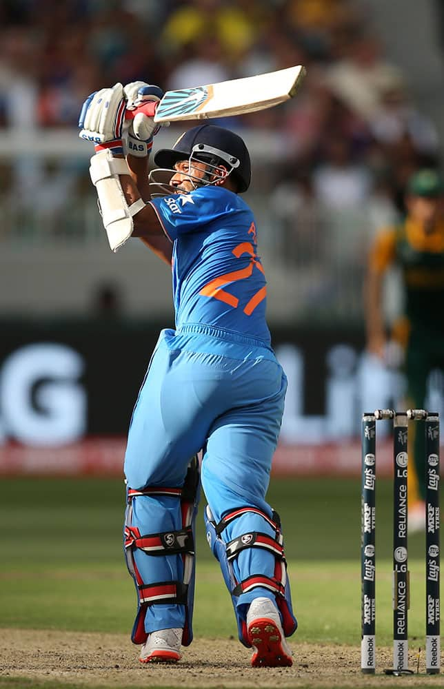 India's Ajinkya Rahane, plays a shot during their Cricket World Cup pool B match against South Africa in Melbourne, Australia.