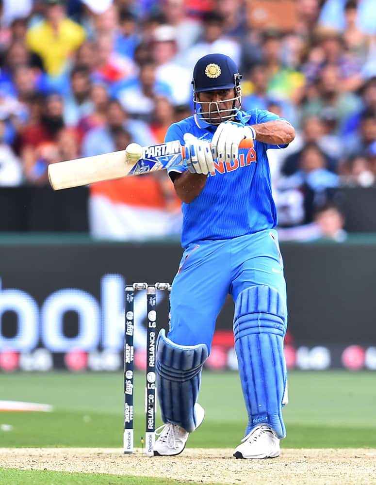 India's M S Dhoni hits the ball during their Cricket World Cup pool B match against South Africa in Melbourne, Australia.