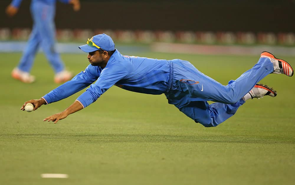 India's Suresh Raina fields during their Cricket World Cup pool B match against South Africa in Melbourne, Australia.