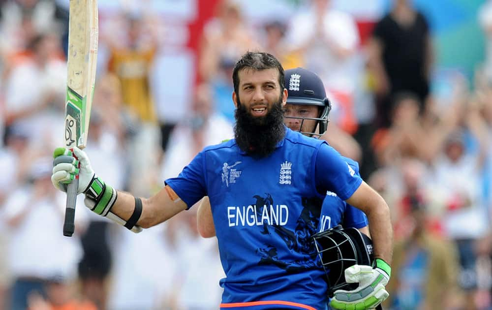 England's Moeen Ali waves to the crowd after reaching a century during their Cricket World Cup match against Scotland in Christchurch, New Zealand.