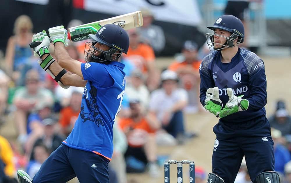 England's Moeen Ali play's a pull shot as Scotland's wicketkeeper Matt Cross follow's the ball during their Cricket World Cup match in Christchurch, New Zealand.