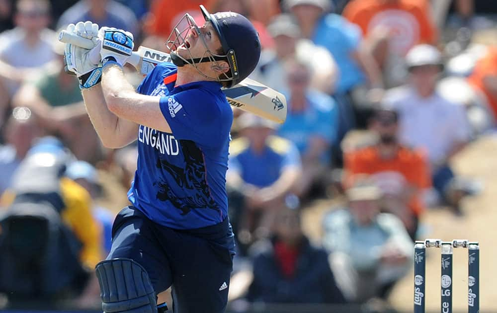 England's captain Eoin Morgan watches the ball during their Cricket World Cup match against Scotland in Christchurch, New Zealand.