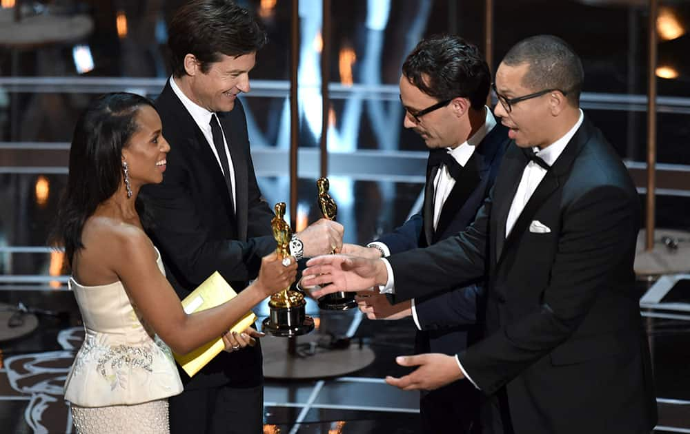 """Kerry Washington, from left, and Jason Batemen present Mat Kirkby and James Lucas with the award for best live action short film for """"The Phone Call"""" at the Oscars, at the Dolby Theatre in Los Angeles."""